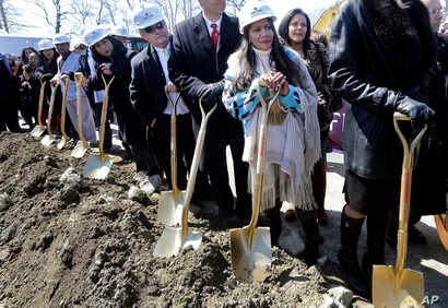 FILE - In this April 5, 2016 file photo, Mashpee Wampanoag Tribal Council member Winnie Johnson Graham, foreground, holds a…