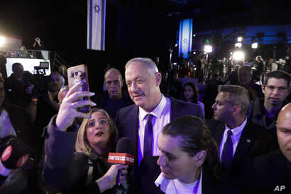 Blue and White party leader Benny Gantz arrives after exit polls for the Israeli elections at party's headquarters in Tel Aviv,…