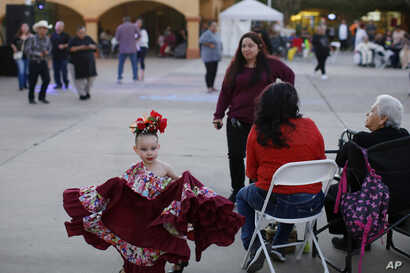 In this Feb. 8, 2020, photo, people gather during the celebration of the town's 45th year since it was incorporated, in…