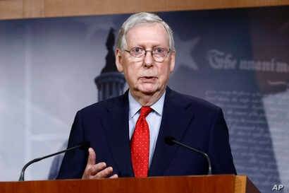 FILE - In this April 21, 2020, file photo Senate Majority Leader Mitch McConnell of Ky., speaks with reporters after the Senate…