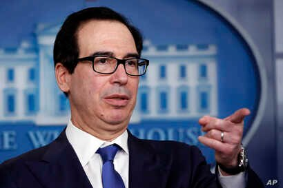 Treasury Secretary Steven Mnuchin speaks about the coronavirus in the James Brady Press Briefing Room at the White House,…