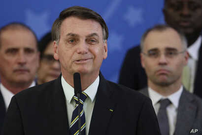Brazil's President Jair Bolsonaro speaks during a press conference on the resignation of Justice Minister Sergio Moro, at the…