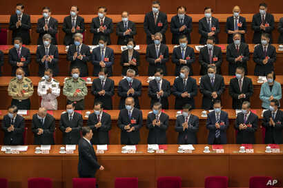 Delegates applaud as Chinese President Xi Jinping arrives for the closing session of China's National People's Congress (NPC)…