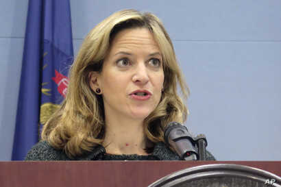 FILE - In this March 5, 2020, file photo, Michigan Secretary of State Jocelyn Benson speaks at a news conference in Lansing,…