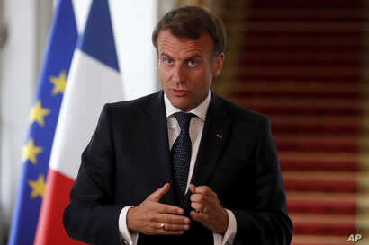 French President Emmanuel Macron speaks after a video-conference summit on vaccination at the Elysee Palace in Paris, Monday,…