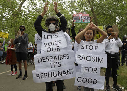 Protesters take part in a demonstration on Wednesday, June 3, 2020, in Hyde Park, London, over the death of George Floyd, a…