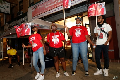Volunteers for and supporters of longtime U.S. Rep. Yvette Clarke, D-N.Y., gather outside Clarke's campaign headquarters,…