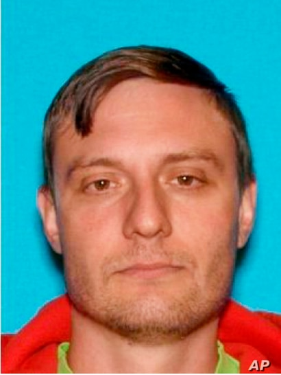 This undated Department of Motor Vehicles photo provided by the FBI shows Robert Alvin Justus Jr., who has been charged with…