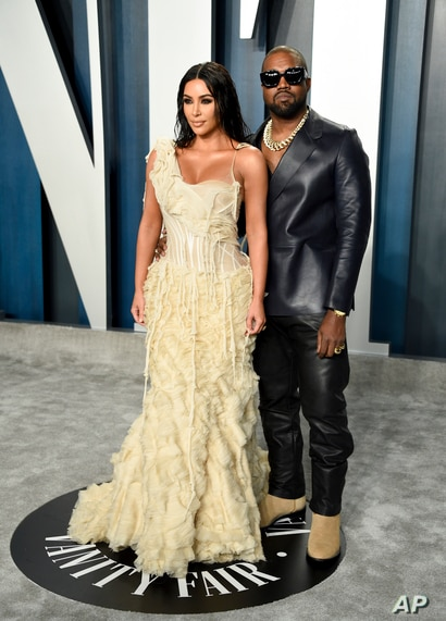 Kim Kardashian West, left, and Kanye West arrive at the Vanity Fair Oscar Party on Sunday, Feb. 9, 2020, in Beverly Hills,…