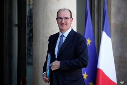 France's new prime minister Jean Castex arrives at the Elysee Palace for the weekly cabinet meeting, in Paris, France, Tuesday…