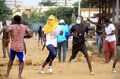 Demonstrator opposed to Ivory Coast President Alassane Ouattara running for a third term confront riot police in Abidjan…