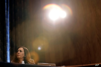 Sen. Kamala Harris, D-Calif., listens during a Senate Homeland Security and Governmental Affairs Committee hearing to examine…