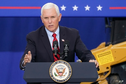 FILE - In this Tuesday, Sept. 1, 2020, file photo, Vice President Mike Pence speaks at a campaign event on the grounds of…