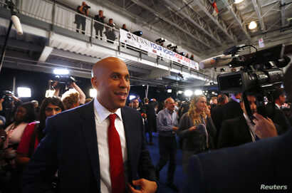 Senator Cory Booker works his way through the spin room after the 2020 Democratic U.S. presidential debate in Houston, Texas, U.S. September 12, 2019. REUTERS/Jonathan Bachman
