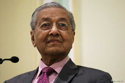 Malaysia's Prime Minister Mahathir Mohamad reacts during a news conference in Putrajaya, Malaysia, September 18, 2019. REUTERS/Lim Huey Teng