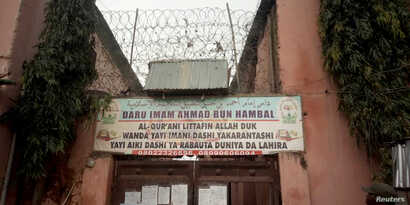 A sign is seen above a house where police rescued men and boys in Kaduna, Nigeria, September 27, 2019. The sign reads: 'Imam Ahmad Bun Hambal center for Islamic studies'.  REUTERS/Stringer NO RESALES. NO ARCHIVES