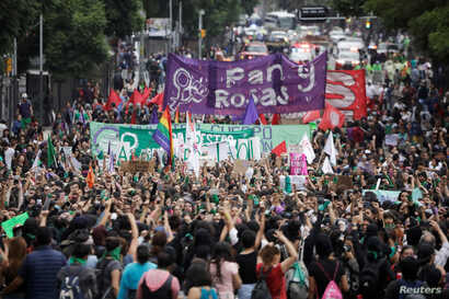 """Women take part in a protest, part of a movement known as """"Marea Verde"""", to mark the International Safe Abortion Day in Mexico City, Mexico September 28, 2019. REUTERS/Luis Cortes"""