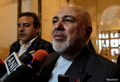 Iran's Foreign Minister Javad Zarif speaks with the media on the sidelines of a security conference in New Delhi, India,…