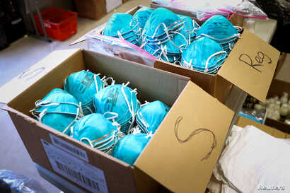 FILE PHOTO: Boxes of N95 protective masks for use by medical field personnel are seen at a New York State emergency operations…