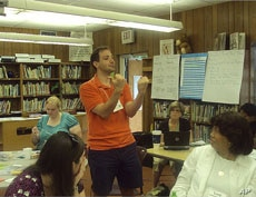 Peter Gaughan demonstrates a fluency exercise during a Singapore math training session.