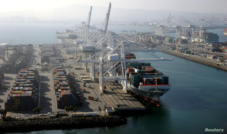 FILE - A container ship is docked at the Ports of Los Angeles and Long Beach, Calif., in this aerial photo, Feb. 6, 2015. Once the trade war sets in, shipping rates for all good will likely increase, said Stephen Cheung, president of the World Trade ...