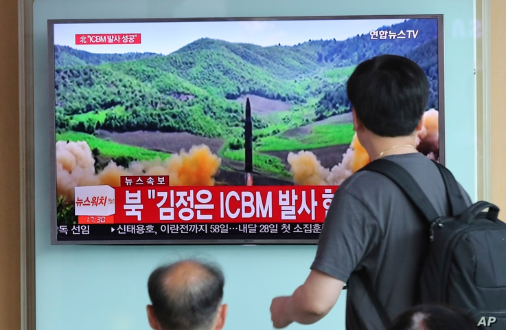 People watch a local TV news showing what was said to be the launch of a Hwasong-14 intercontinental ballistic missile, ICBM, aired by North Korea's KRT, at Seoul Train Station in Seoul, South Korea, July 4, 2017.