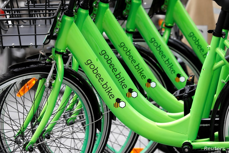 """Several """"Gobee.bike"""" bicycles, a city bike-sharing service, by Hong Kong startup Gobee.bike, are seen on a sidewalk in Paris, France, Oct. 10, 2017."""