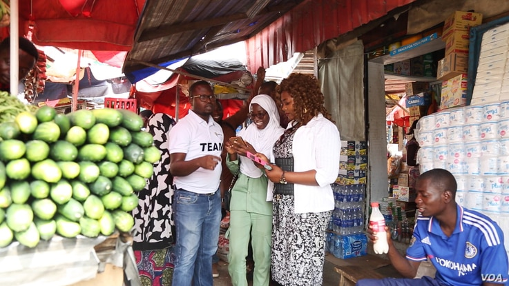 Tech entrepreneur, Tomi Ayorinde of MobileForms, and three of his colleagues visit a market in the Nigerian capital of Abuja to poll vendors on the price of their goods. The data is captured on mobile phones in an effort to increase the availability ...