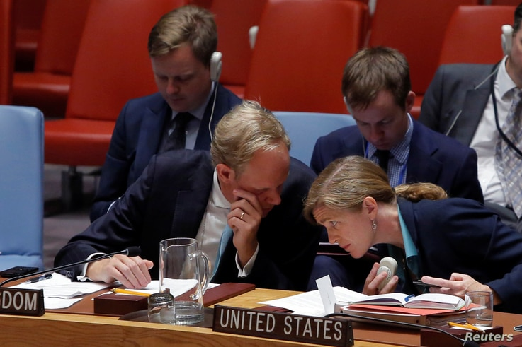 British Ambassador to the United Nations Matthew Rycroft speaks with U.S. Ambassador to the United Nations Samantha Power during a high level meeting on Syria by the United Nations Security Council at the United Nations in Manhattan, New York, Sept. ...