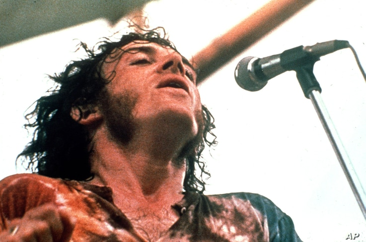 FILE - Joe Cocker performs at the Woodstock Festival of Arts and Music in Bethel, New York, August 1969.
