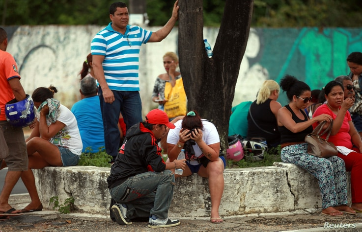 Relatives of prisoners await news of the fate of their loved ones, in front of the Medical Legal Institute, after a bloody prison riot in the Amazon jungle city of Manaus, Brazil, Jan. 2, 2017.