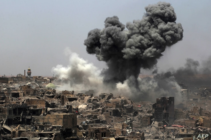 A picture taken on July 9, 2017, shows smoke billowing following an airstrike by US-led international coalition forces targeting Islamic State (IS) group in Mosul.