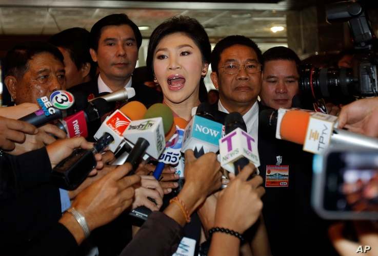 FILE - Thailand's former prime minister, Yingluck Shinawatra, talks to reporters at parliament in Bangkok, Jan. 9, 2015.