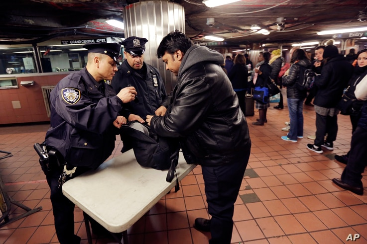 New York City Police Department Transit officers do a random bag check at the subway station under Grand Central Terminal, in New York, March 22, 2016.