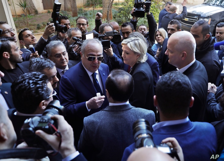 French far-right presidential candidate Marine Le Pen, center, leaves Dar al-Fatwa building, the headquarters of the Sunni Mufti, after she refused to wear a head scarf to meet with Lebanon's Grand Mufti Sheikh Abdel-Latif Derian, in Beirut, Lebanon,...