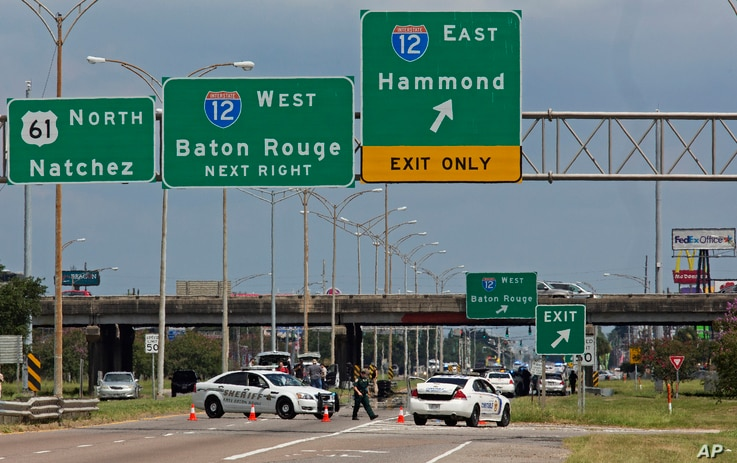 Baton Rouge police block Airline Highway after police were shot in Baton Rouge, La., Sunday, July 17, 2016.