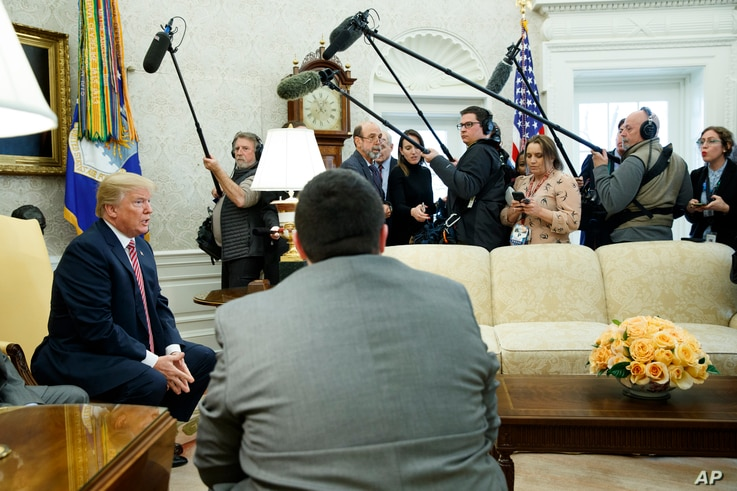 President Donald Trump speaks to reporters in the Oval Office of the White House, Feb. 9, 2018, in Washington.