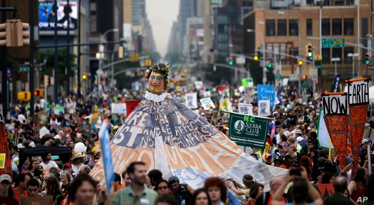FILE - People fill the street during the People's Climate March in New York, Sept. 21, 2014.