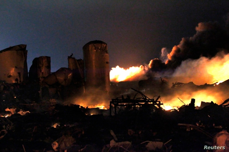 The remains of a fertilizer plant burn after an explosion at the plant in the town of West, near Waco, Texas early April 18, 2013. The deadly explosion ripped through the fertilizer plant late on Wednesday, injuring more than 100 people, leveling doz...