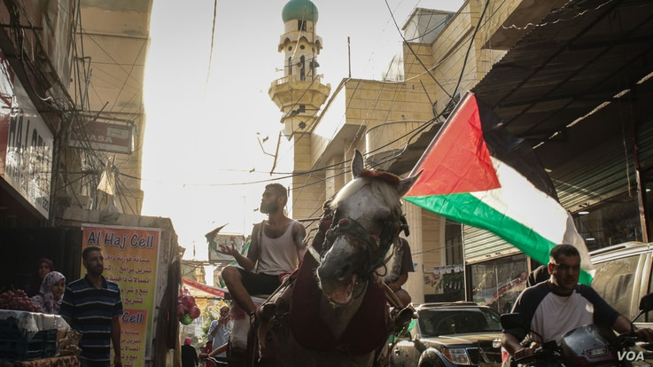 Some claim that improving the rights of Palestinian refugees will lessen their desire to return to their homeland - an argument that many Palestinians reject. (J. Owens/VOA)