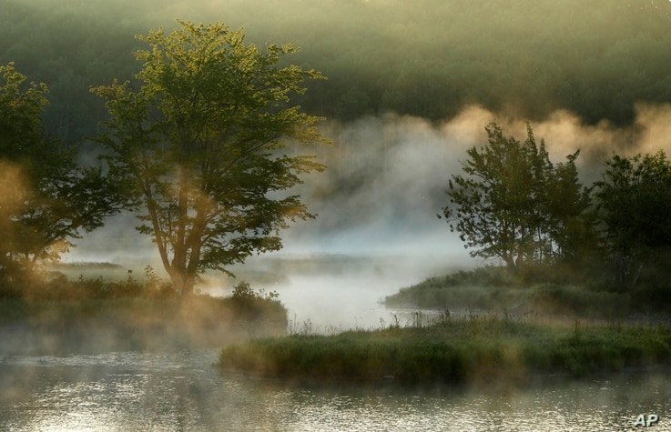 In this Aug. 10, 2017, photo, fog rises from the Penobscot River's East Branch in the Katahdin Woods and Waters National Monument near Patten, Maine.