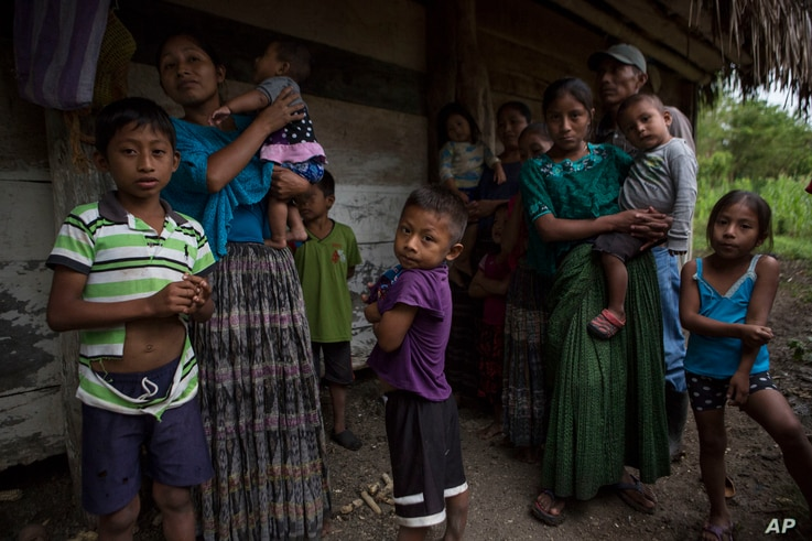 Members of the Caal Maquin family and neighbors stand in front of Claudia Maquin's house in Raxruha, Guatemala, Dec. 15, 2018. Claudia Maquin's daughter, 7-year-old Jakelin Caal Maquin, died in a Texas hospital, two days after being taken into custo...