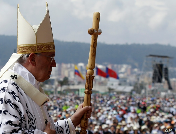 Pope Francis walks with his pastoral staff to celebrate Mass at Bicentennial Park in Quito, Ecuador, July 7, 2015.