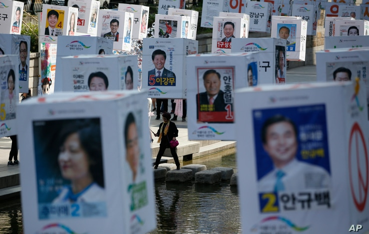Candidates' posters for the upcoming general elections are hung on strings over the Cheonggye stream in downtown Seoul, South Korea, Monday, April 11, 2016.