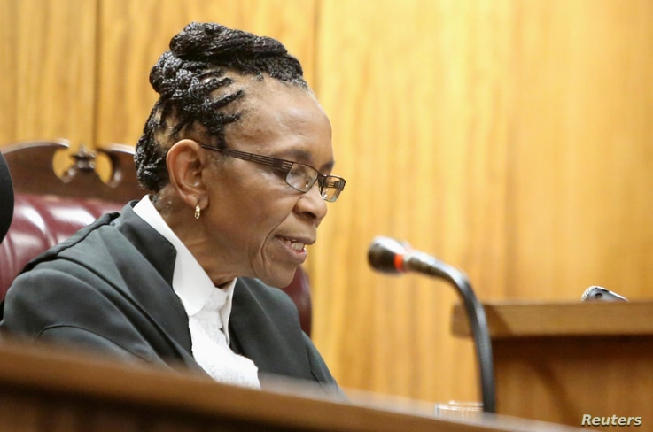 Judge Thokozile Masipa delivers judgment during the appeal by prosecutors against the verdict and sentence of Oscar Pistorius in the North Gauteng High Court in Pretoria, December 10, 2014. South African prosecutors on Wednesday won their bid to appe...