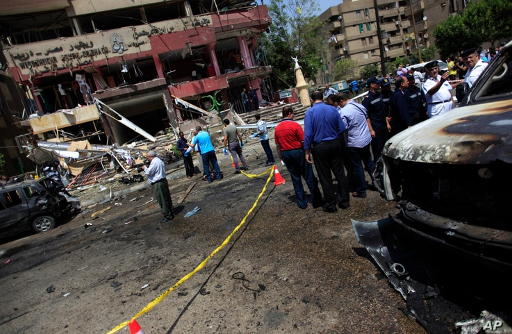 Security personnel gather at a site of an explosion near the convoy of the Egyptian Interior Minister Mohamed Ibrahim, Cairo, Sept. 5, 2013.