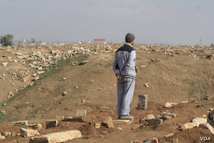 Many residents, like Hassam Ali, are heartbroken because additional bodies have been added to their loved ones' graves in Mosul, Iraq, Jan. 29, 2017. (H. Murdock/VOA)