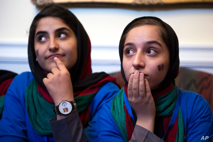 Afghanistan's FIRST Global Challenge team member Lida Azizi, left, and Fatemah Qaderyan meet with reporters following the opening ceremony in Washington, July 16, 2017.