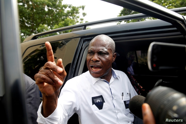 FILE - Martin Fayulu, runner-up in Democratic Republic of Congo's presidential election enters his car after delivering his appeal contesting the Congo's National Independent Electoral Commission results at the constitutional court in Kinshasa, Democ