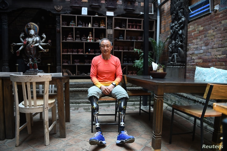 FILE - Chinese double amputee climber Xia Boyu, who lost both of his legs during his first attempt to climb Mount Everest, poses during an interview with AFP at Bhaktapur on the outskirts of Kathmandu, Nepal, April 04, 2018.